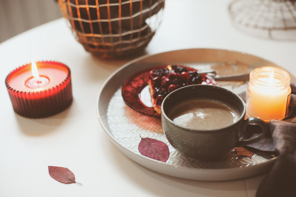 Cozy winter weekend at home. Morning with coffee or cocoa, berry pie and candle lights.