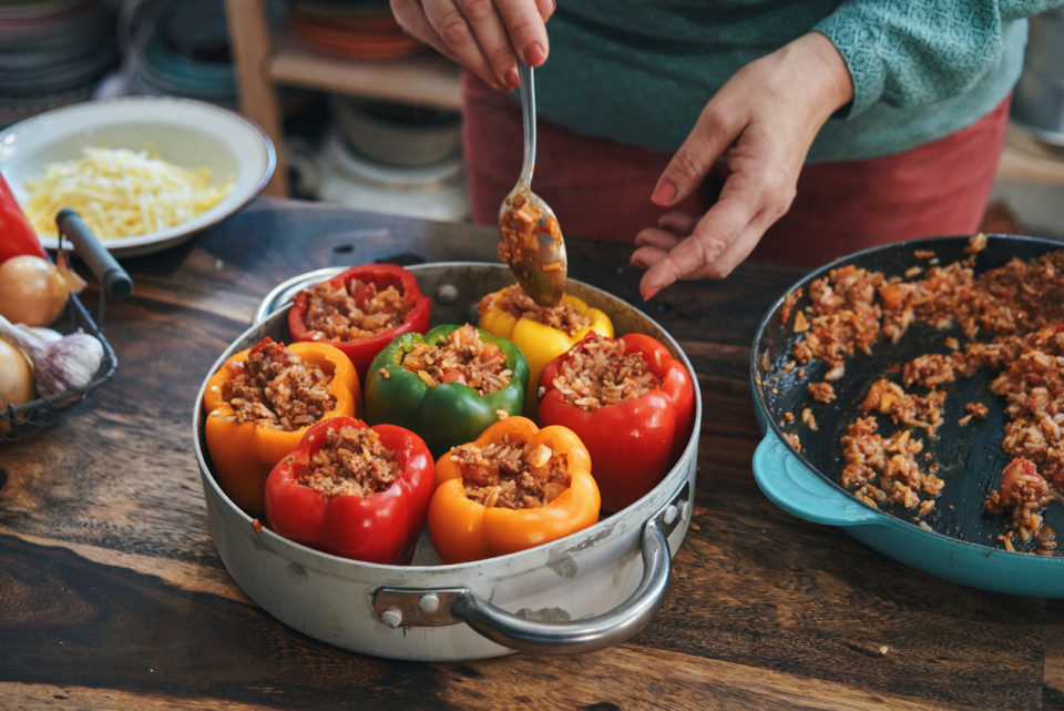 Preparing Stuffed Bell Peppers with Ground Meat in Tomato Sauce